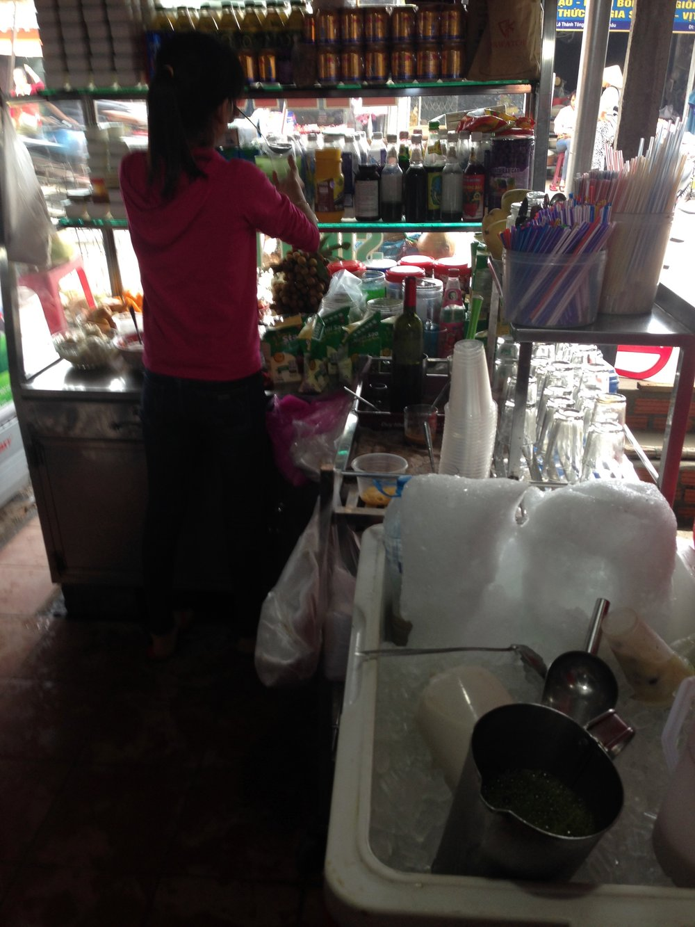 The inside view of a Tam's sinh to stall. The whole fruits are on shelves to the left out of picture. The ice is kept in an esky, and the ice vendor visits a couple of times a day, straight from the ice factory. Try to get yourself some bamboo straws when you arrive in Vietnam and say NO to the plastic straw!! The cash is thrown haphazardly in a draw that is part of the cart. No money till needed.