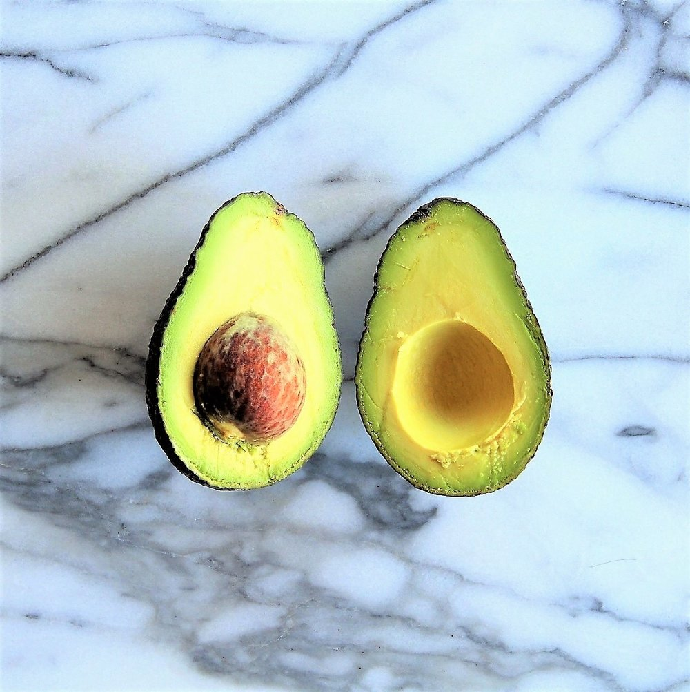 Slice the avocado in half lengthwise.
