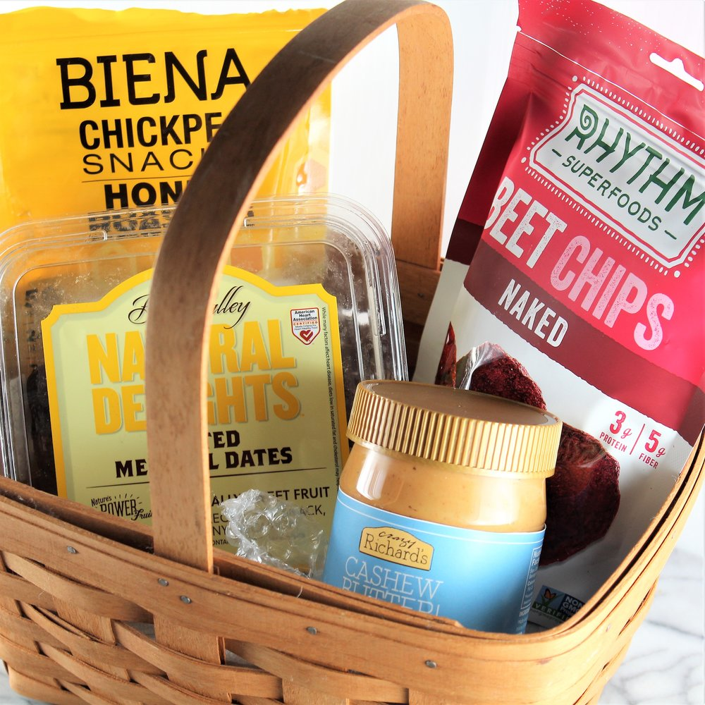 Snacks - Because who doesn't love a good snack basket?! Some of my favorites include: Biena Foods Chickpea Snacks, Rhythm Superfoods Beet Chips, Crazy Richards Cashew Butter, and Natural Delights Medjool Dates.