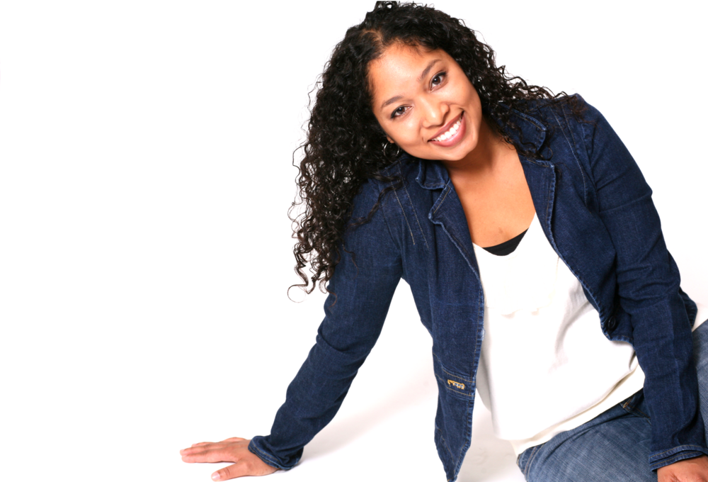 Dija in jean jacket sitting and smiling.png
