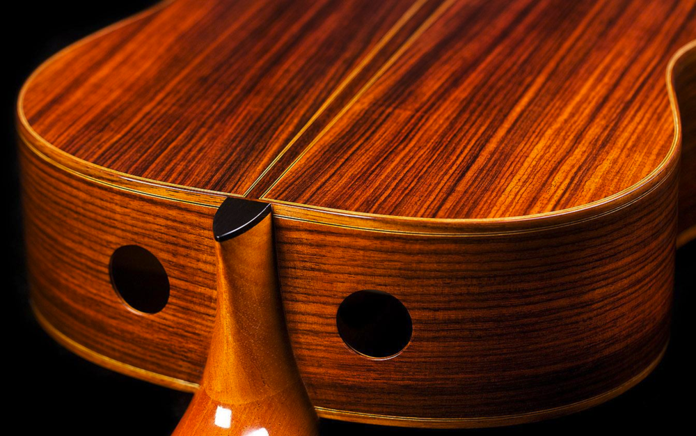 Dual soundports on a guitar by kenny hill