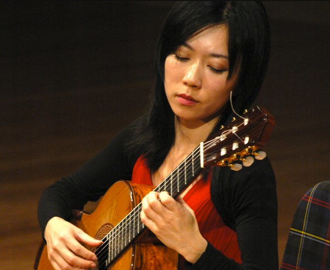 Xuefei yang playing one of her greg smallman guitars in concert.