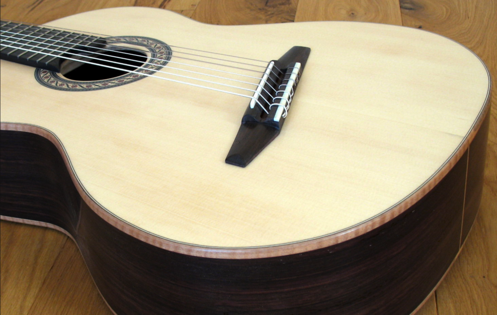 'Angled bridge' on a Stoll guitar.