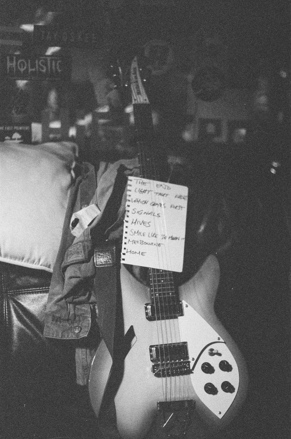 black and white, guitar with set list through the strings