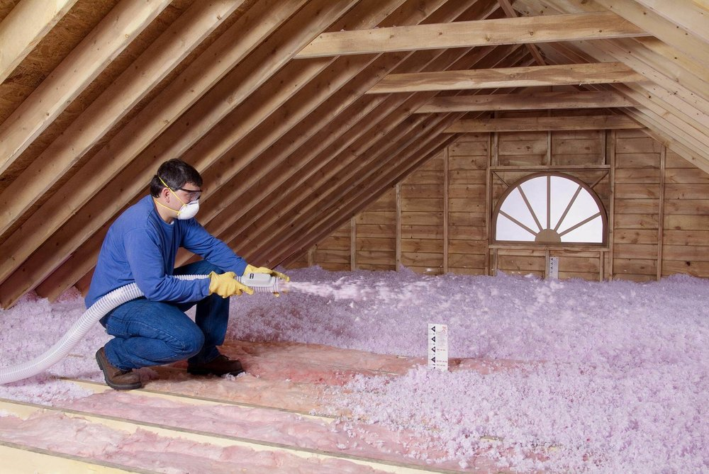 Contractor-Blowing-Insulation-in-an-unfinished-attic-1.jpg