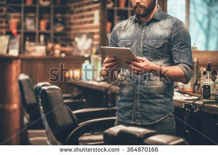 stock-photo-digital-technologies-in-any-business-close-up-of-young-bearded-man-holding-digital-tablet-while-364870166.jpg