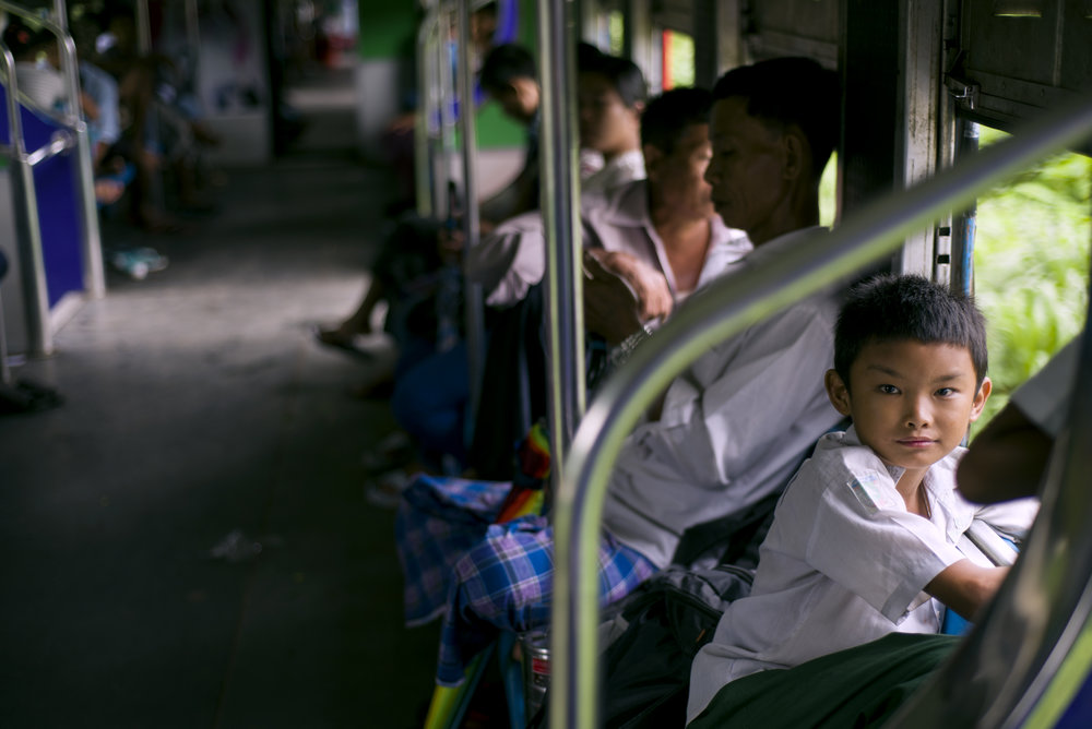 Child on board the circle line in Yangon