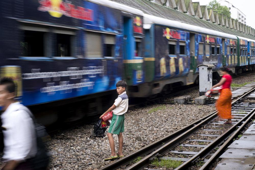 BOY ON TRACK AT STATION.jpg