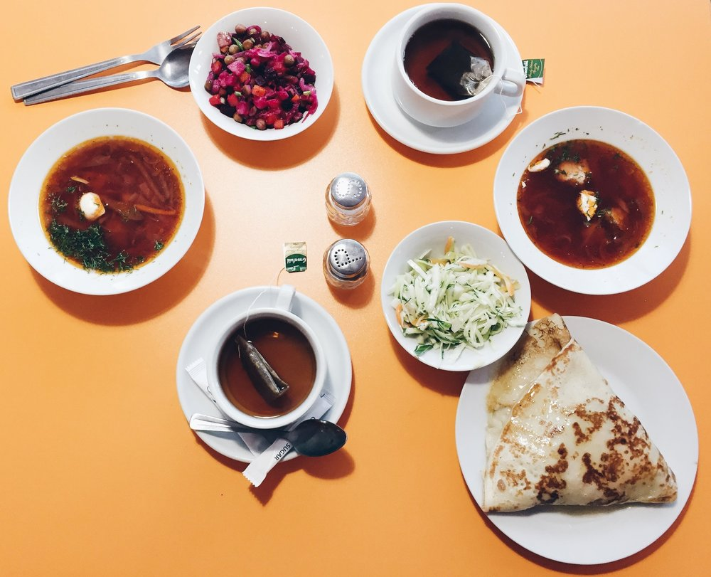 Soup: Borscht  Salads: Beet (left); Cabbage (right) Blini: Ham, mushroom, and cheese Drink: Black honey tea