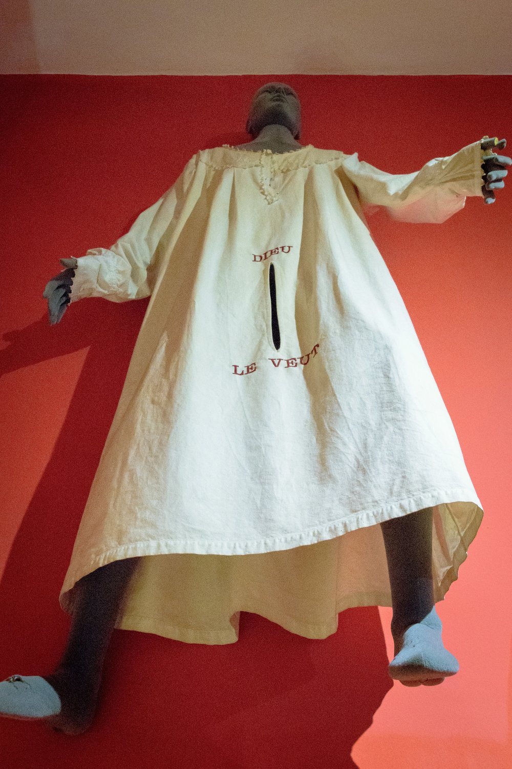 "romantic man's nightgown, with ""Dieu le veut"" translating to ""God willing"""