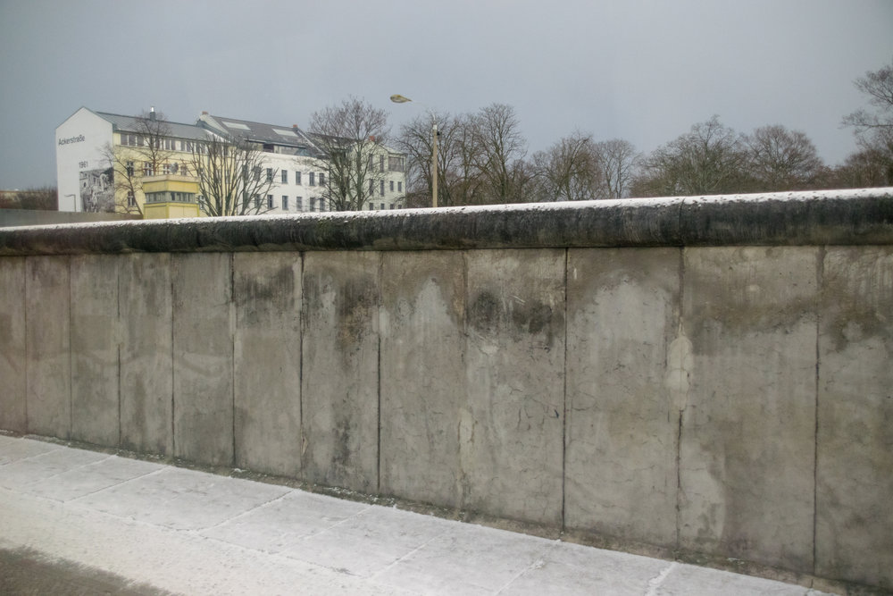 the top of the wall was curved to make grasping impossible to prevent jumpers
