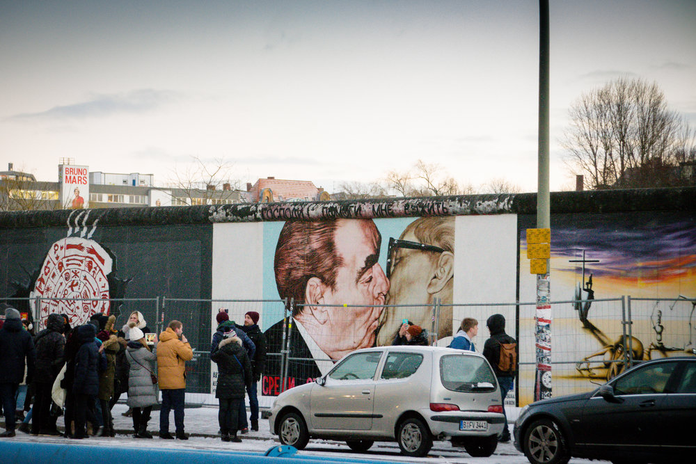 Berlin's East Side Gallery's (nearly a mile long!) most famous painting of Soviet leader Leonid Brezhnev kissing the East Germany President Erich Honecker ('The Kiss')