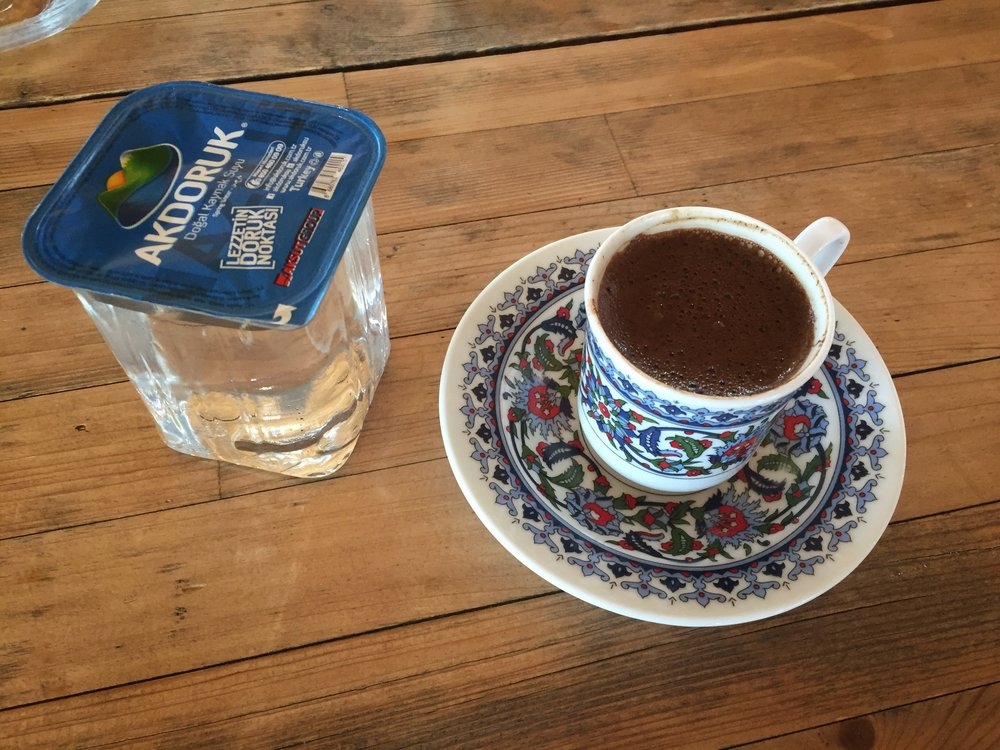 Turkish coffee, always served with a side of water
