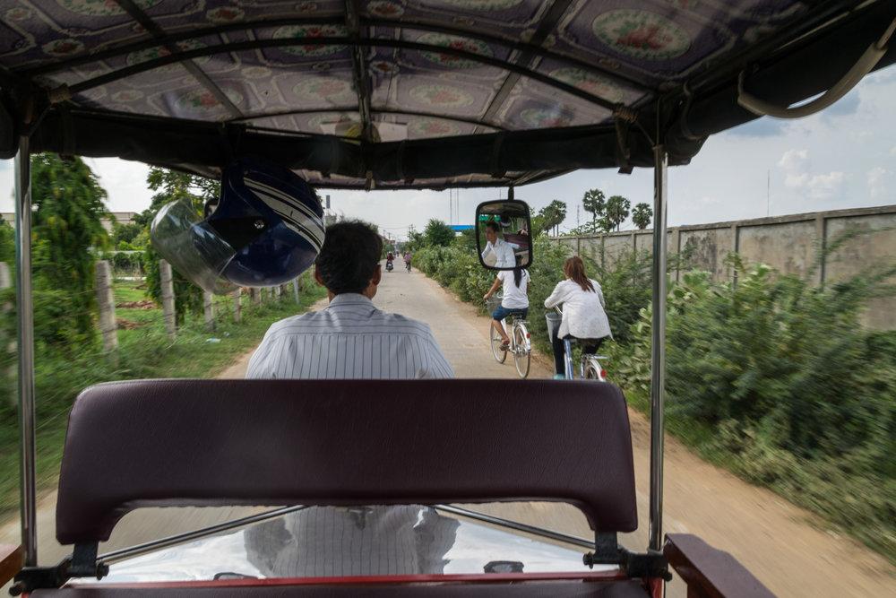 school kids bike home in Phnom Penh, Cambodia