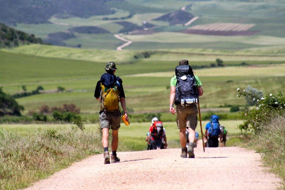pilgrims heading to Santiago de Compostela (photo credit:  veermag.com )
