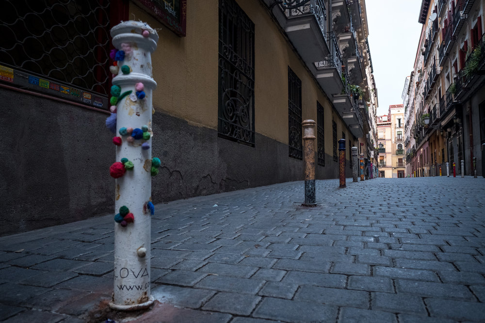 posts are individually decorated on Calle Galería de Robles