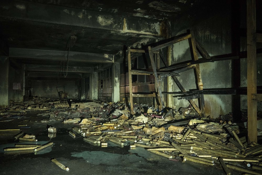 a room full of soggy, charred bottling supplies, looks more like an abandoned gift wrapping room
