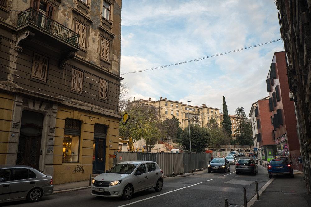 narrow sidewalks double as impromptu parking spaces
