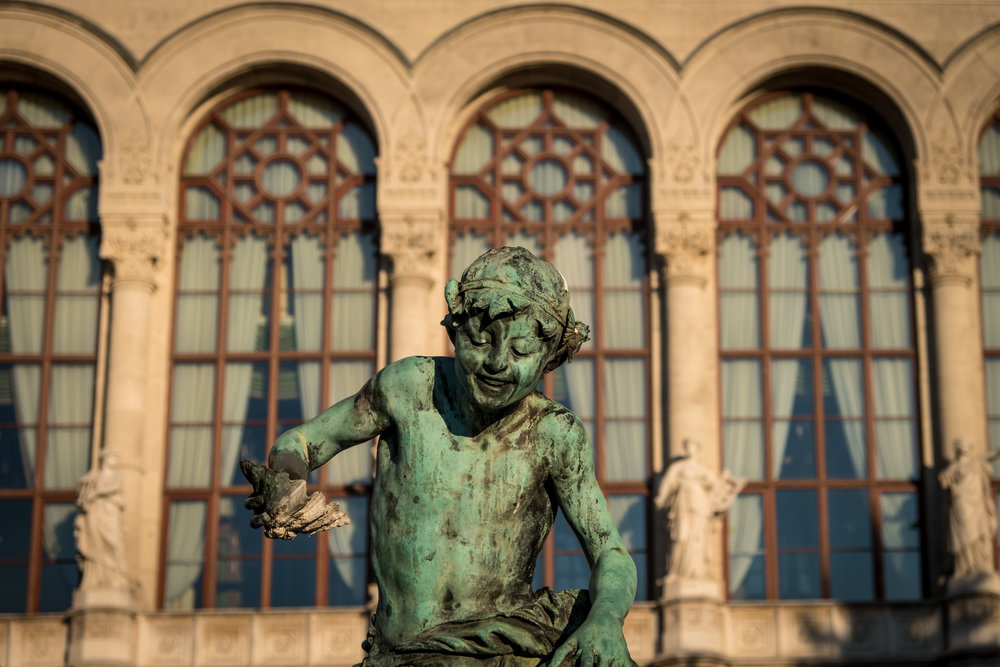 statue in Vigadó Square with the concert hall in the background