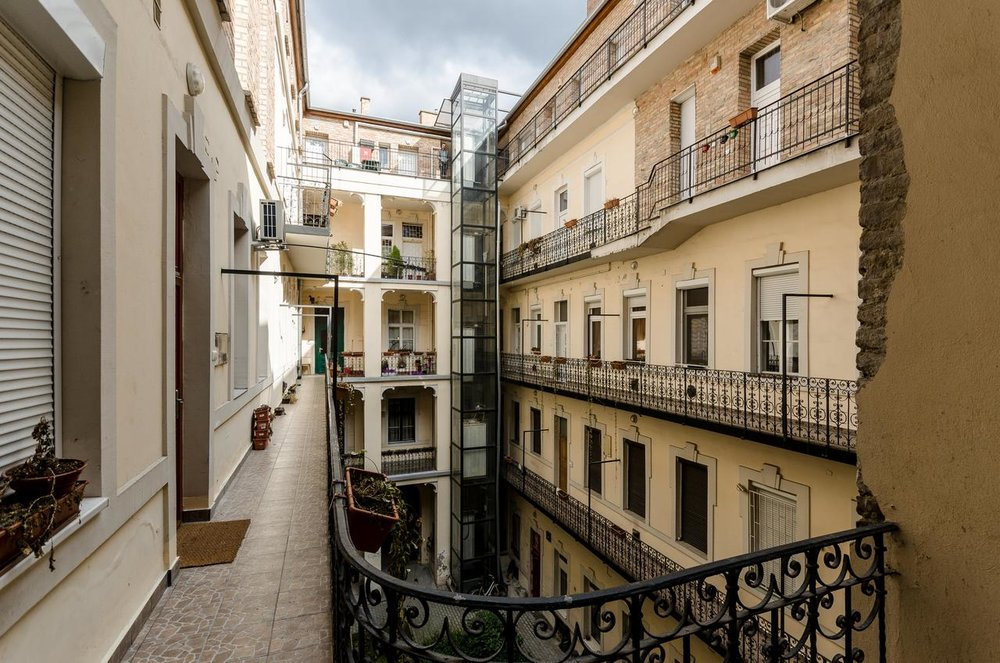 stunning atrium of my apartment in the Jewish Quarter (photo credit: Booking.com)