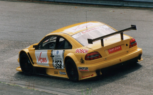 The C70 roars through Karrussell, Nürburgring 2000.