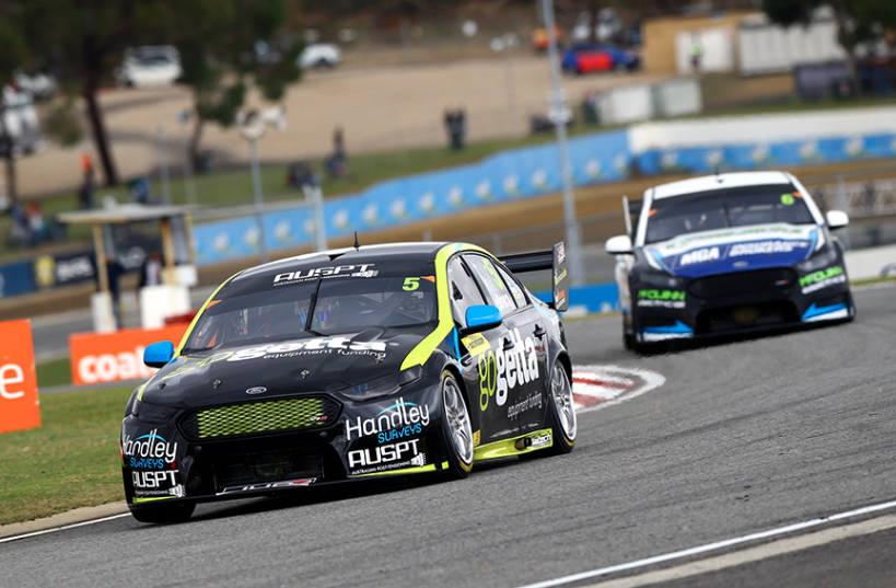 Jack LeBrocq leads Garry Jacobson in the Dunlop series race at Barbagallo