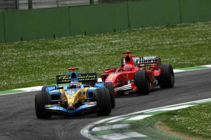 Alonso holding up the Ferrari of Schumacher to claim his third consecutive victories at Imola