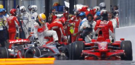 Hamilton and Raikkonen climbing out of their cars following the incident at Montreal