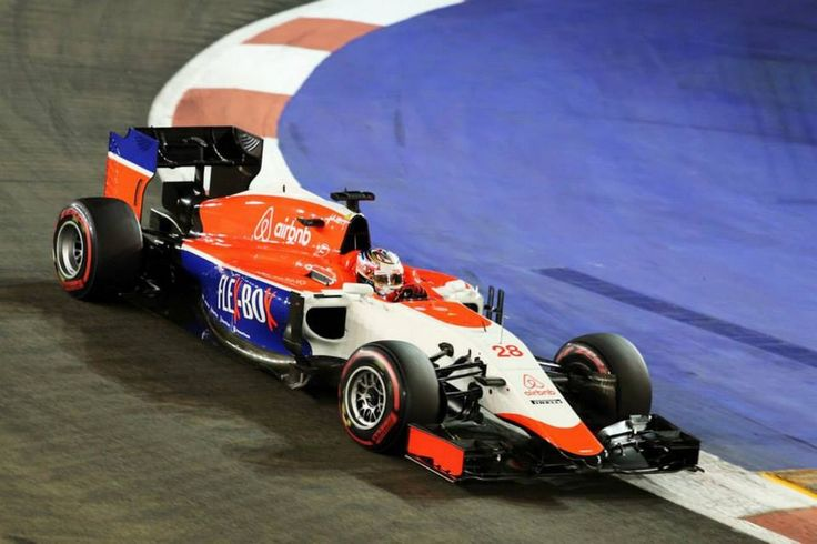 Will Stevens driving the MR03B at the 2015 Singapore Grand Prix