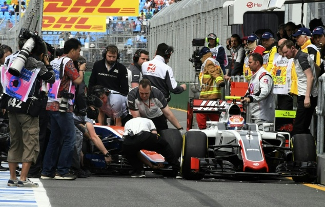 Engineers from both Haas and Manor tried frantically to free Haryanto and Grosjean after their collision during practice of the Australian Grand Prix