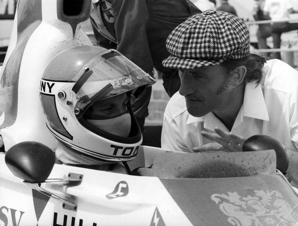 The charismatic champion having a chat with his apprentice: Graham Hill and Tony Brise before the start of the 1975 British Grand Prix