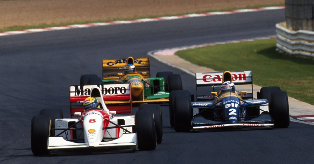 Senna fighting Prost and Schumacher for the lead, Kyalami 1993.