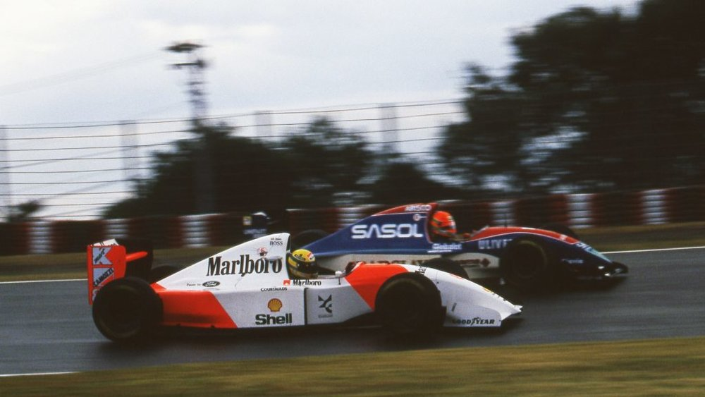 Senna angrily attacks the hard-charging Eddie Irvine.