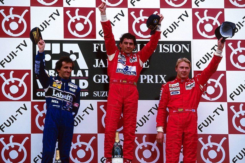 Alain Prost, Ayrton Senna and Mika Häkkinen on the podium, Suzuka 1993.
