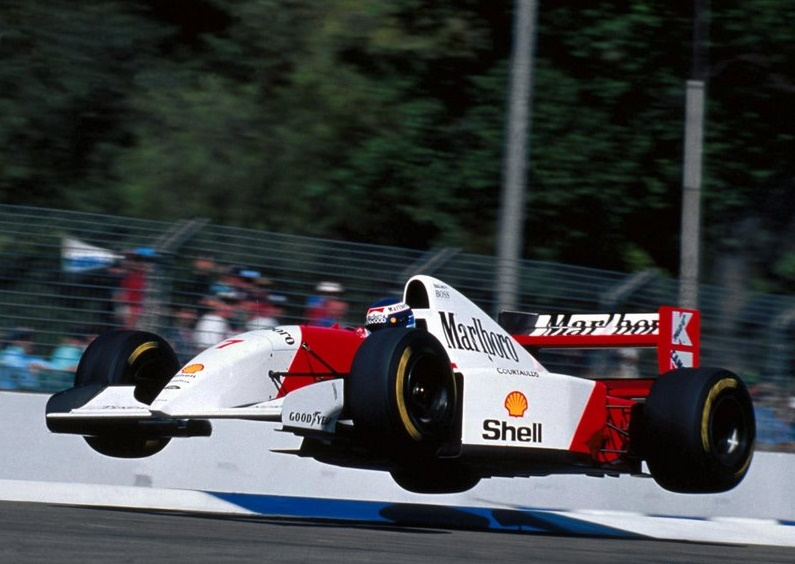Flying Finn Mika Häkkinen earning his nickname with a jump during practice, Adelaide 1993.