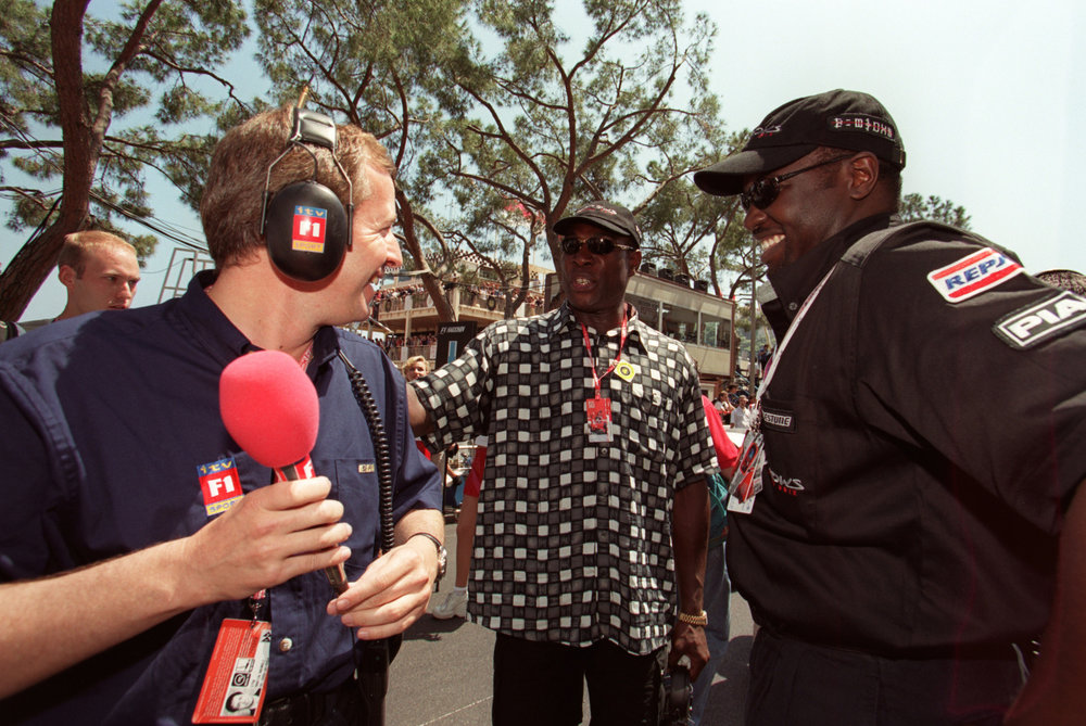 Prince Malik Ado Ibrahim (right) with ITV F1-reporter Martin Brundle and boxing legend Frank Bruno (center).