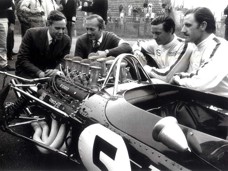 Cosworth's Keith Duckworth, Colin Chapman, Jim Clark and Graham Hill admiring the DFV, Zandvoort 1967.