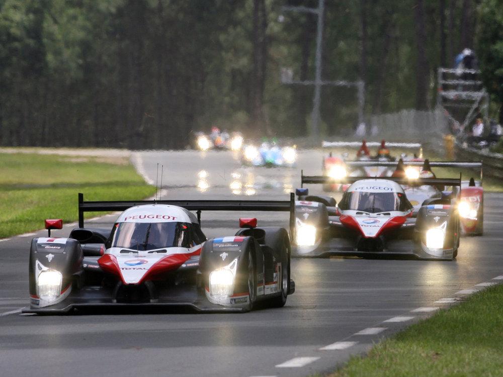 The two 908's being chased by the Audi's of Marco Werner (GER) and Alexandre Premat (FRA).
