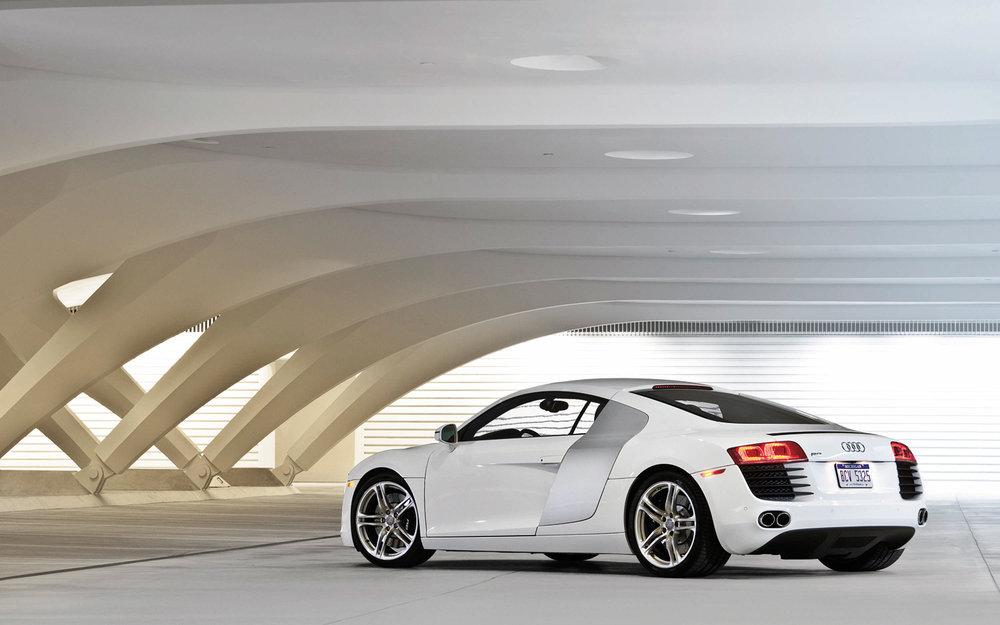 2012-Audi-R8-V8-FSI-Quattro-rear-three-quarters.jpg
