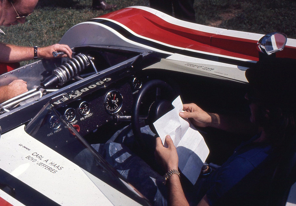 Jackie Stewart in his office. Another added safety feature was soft padding on his steering wheel.
