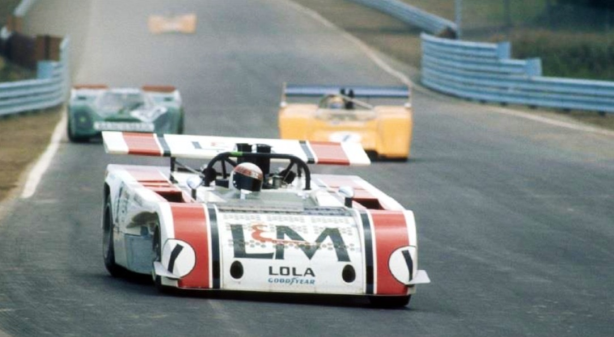Jackie Stewart in front of the two McLarens. Note the Porsche 917K of Mario Cabral being lapped.