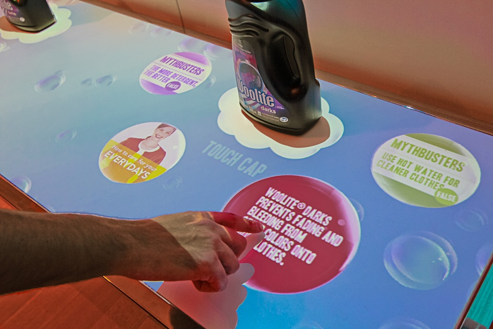 Motion-sensing tech allowed people to play with the bubbles, and showcased new Woolite products by revealing clothing care tips when touched.