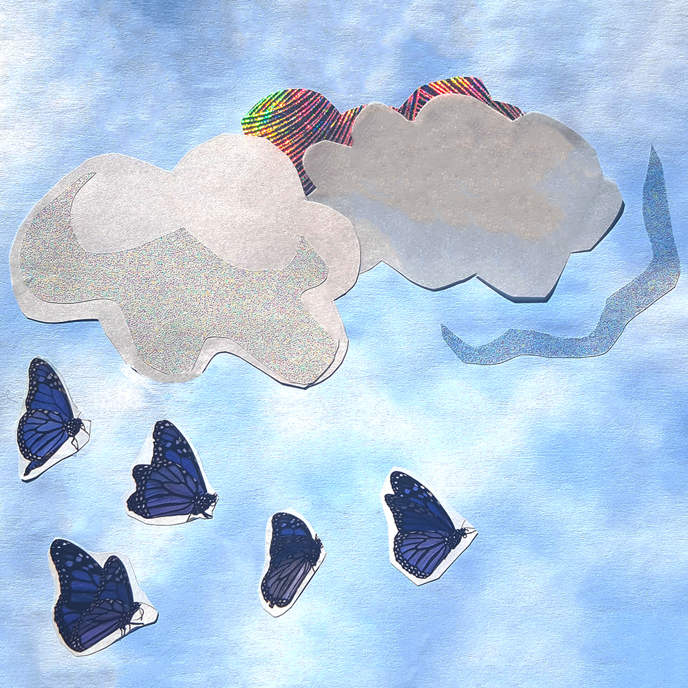 It started with the blue butterflies, which I saw in a magazine. I cut them out and built a world around them, with scrapbook paper for the sky and clouds cut out of wrapping paper.
