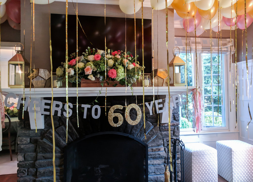 """Custom """"Cheers to 60 Years"""" banner. Chalk gray with gold glitter twine and accent."""