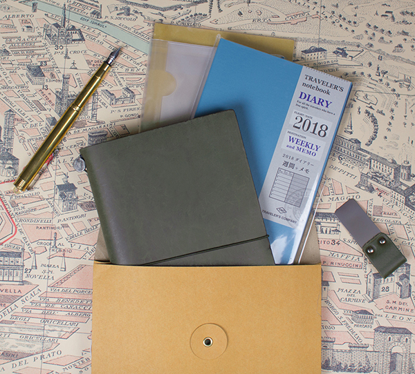 Gift idea for the traveler:  Standard size Traveler's Notebook starter kit in your choice of four colors (including the Limited Edition Olive, shown here), pen clip, 2018 Dated Weekly and Memo,  and card file to keep track of mementos, all for just over $100, gift bag included. Add the brass fountain pen to make this a perfect companion for any adventure. Shop our entire Traveler's Notebook selection here.