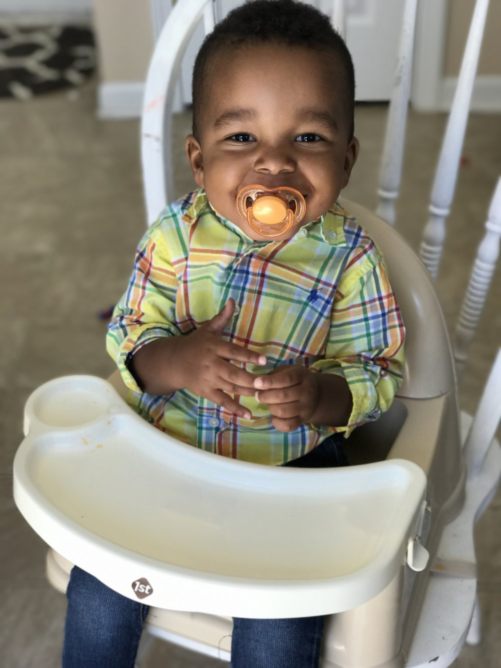 Sweet Micah will realize one day how much fun it is to eat!