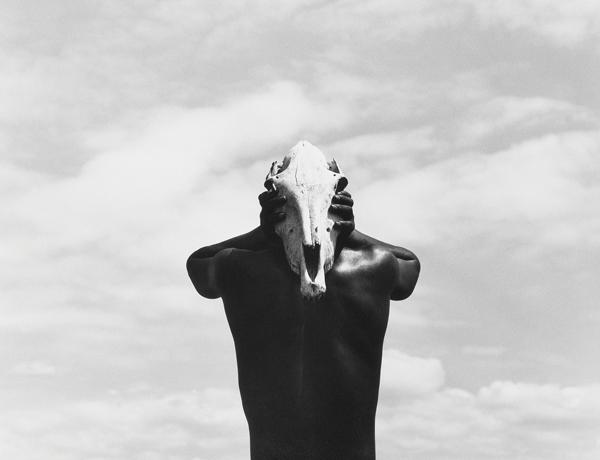 HerbRitts_Eona-Holding-Zebra-Skull.jpg