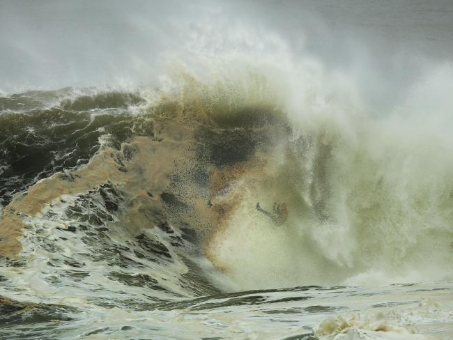 Allport is swallowed up by this monster. Picture:  Brett Costello