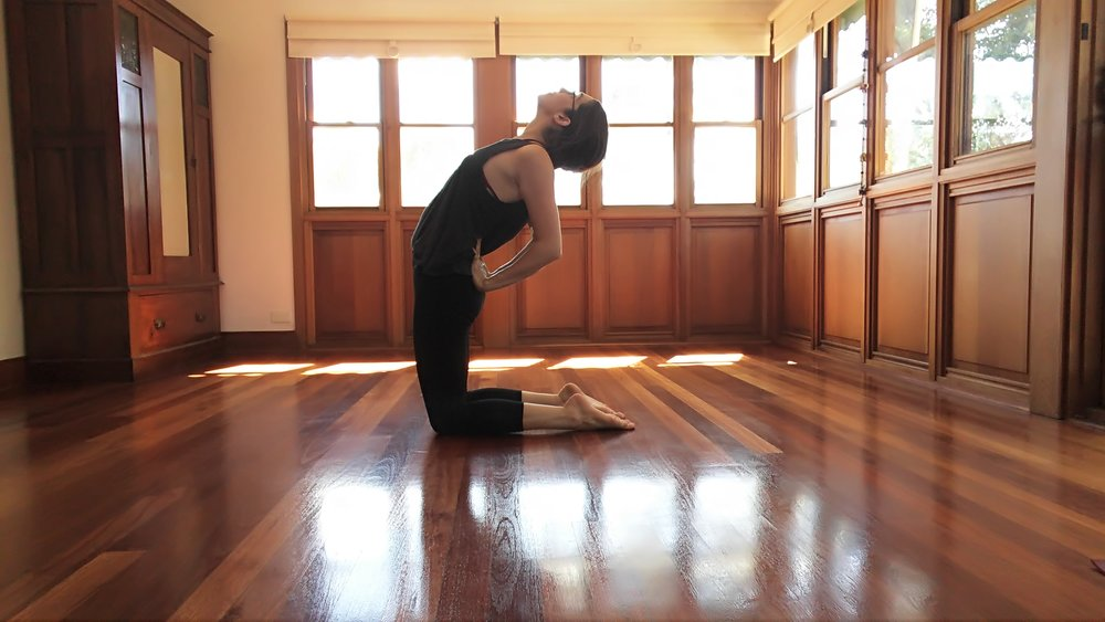 Stand on your knees. Bring hands to lower back (if comfortable, fingers pointing towards the head). Keep arms parallel and pulling in towards one another. Engage belly to stabilise the lower back. Slowly broaden the chest, allowing the upper back to bend backwards.