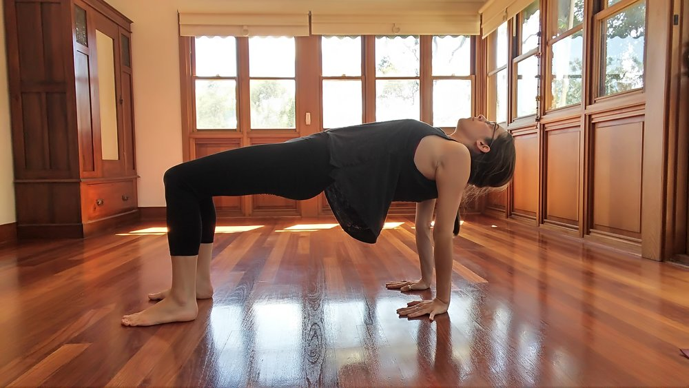 From the last pose, ground into hands and feet. Engage belly and pull pelvis up into a reverse table top position. Broaden through front side of the body. Feel the stretch in the shoulders as well.